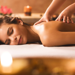 Young woman at the spa receiving back massage.